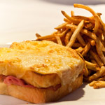 Croque Monsieur (Ham and Cheese Sandwich with Gruyère cheese and mustard cream sauce)